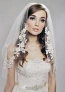 Kiểu tóc cho cô dâu mặt vuông bớt góc cạnh